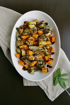 Roasted butternut squash, Brussels sprouts, and shallots with sage, Parmesan cheese, and a balsamic reduction.