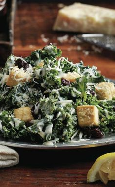 Kale Caesar Salad with Tofu Croutons recipe: A creamy Caesar is heavy on calories and low on nutrition. Our version dresses superfoods kale and cherries in a tangy, creamy vinaigrette (shhh, it's tofu!) that's outrageously good. Baked tofu croutons add a fabulous 27 g of protein to each plate. #MeatlessMonday
