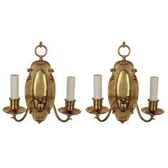 A Pair Of Cast Brass Sconces | From a unique collection of antique and modern wall lights and sconces at https://www.1stdibs.com/furniture/lighting/sconces-wall-lights/
