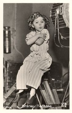 vintage photo Shirley Temple sticking out tongue