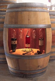 This Lighted Full Barrel Wine Cabinet has a large center cut-out shelf with a rack above for your wine glasses. The self has holes in it that allow you to store your wine bottles correctly with the cork down, but this cabinet can also be used to display your bottles in an upright fashion. The dramatic interior cabinet light highlights the rich interior, which has the color of the wine that originally aged in the cask.
