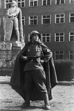 """The Victor - AAMT001049 - Rights Managed - Stock Photo - Corbis. """"The Victor""""; Soviet soldier mimicks Teutonic statue, 1945."""