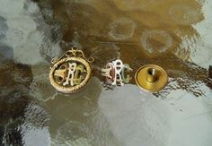 2 diff ORC Railroad Conductor Badge Lapel Pin Watch Fob Ticket Punch Gold ?