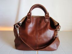 """An Italian leather purse in rich, milky-coffee brown attracts """"who's that lady?"""" stares."""