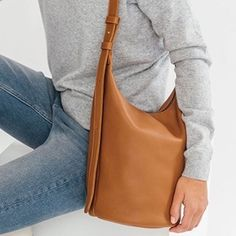 The perfect bucket bag in natural milled leather, fully lined and made in USA. Also available in black | Baggu