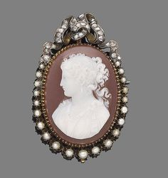 A pearl, hardstone and diamond cameo brooch, circa 1870  The oval hardstone cameo depicting the portrait of a lady facing right, within a half-pearl graduating surround, to a rose-cut diamond surmount, later pin fitting, length 5.7cm