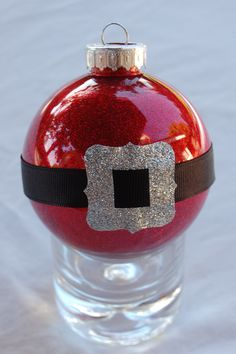 Santa-belt ornament (I've made 10 of these): I decorated clear plastic ornament with Pledge floor wax and Martha Stewart glitter. I adorned them with black grosgrain ribbon and silver buckle (that I punched out of a duck-tape roll).per pinner. Homemade Christmas, Christmas Crafts, Felt Christmas, Beaded Christmas Ornaments, Glitter Ornaments, Handmade Ornaments, Ornaments Ideas, Santa Ornaments, Harry Potter Christmas Decorations