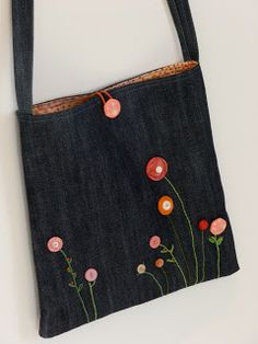 "yesterday's embroidered stems turned into a bag. lined and pocketed, with a hair ""scunci"" for closure. new and vintage buttons and an old pa..."