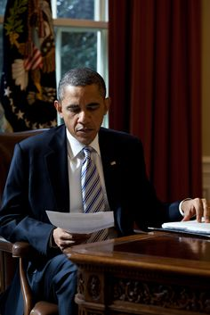 President Obama reads a document in the Oval Office, Feb. 21, 2012
