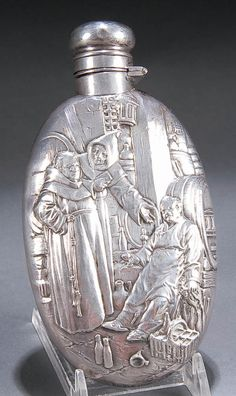 A WALLACE STERLING WHISKEY FLASK early 20th century, with repousse scene of a drunk monk. LOL Antiquities, Flasks, Vintage Silver, Silver Color, Whiskey, Barrel, Jackson, Spirit, Scene