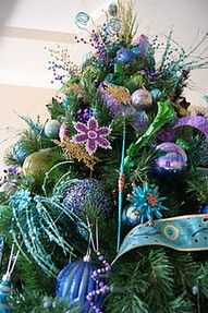 Great Idea on layering the tree! It's the Little Things: How to Layer a Christmas Tree Peacock Christmas Tree, Noel Christmas, Christmas Colors, All Things Christmas, Winter Christmas, Christmas Tree Decorations, Christmas Crafts, Christmas Ornaments, Christmas Ideas