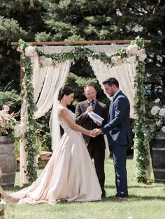 The ceremony took place on a family acreage, where the space was decorated beautifully. They had vintage wine barrels that were topped with gorgeous floral arrangements. The wooden arch that Abby + Brett were married under was draped with soft fabric and pretty floral garlands. Trust me you will want to pin this ceremony!