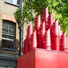 A tiny mobile theatre with chimneys made from coal scuttles played host to audiences of up to six during Clerkenwell Design Week in London 2012.