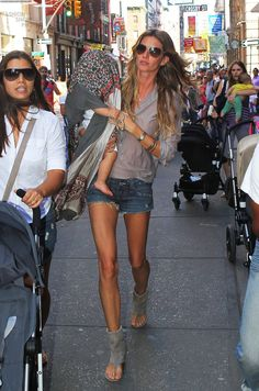 Even wit a baby on her arm she's still gorgeous...actually, it makes her look more real-life like!!!    Gisele