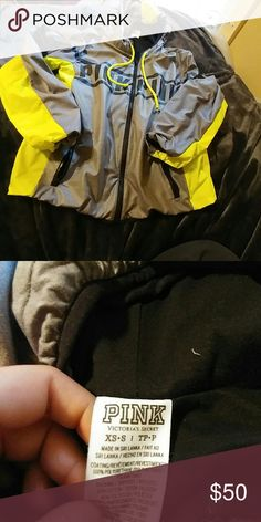 PINK anorak rain jacket style.. Water repellent. Inside is a warm cotton material. Grey with neon yellow. No flaws lightly worn. I would keep it but I need to clean out my closet.    ?Items come from smoke free home ?no trades ?offers accepted w/ offer button  ?can be bundled for 10% off ?next-day ship (weekdays only) PINK Victoria's Secret Jackets & Coats