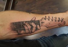 Guitar tattoo by Adept Tattoos
