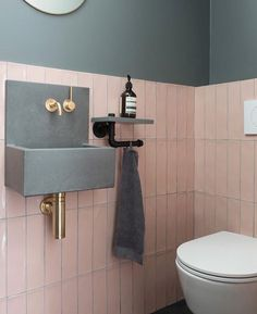 Perfectly pink, our Carter Rose tiles paired with a concrete basin really steals the show in this beautiful cloakroom in Small Downstairs Toilet, Small Toilet Room, Downstairs Cloakroom, Small Toilet Decor, Cloakroom Basin, Toilet Wall, Toilet Sink, Guest Toilet, Wall Mounted Toilet