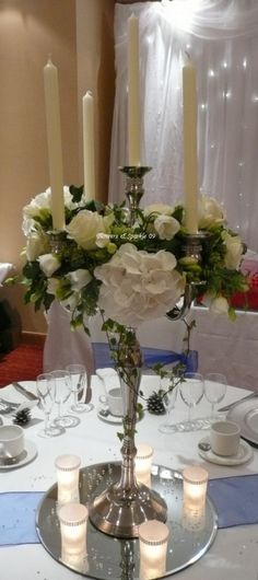 Candelabra simply decorated with flowers in a soft wintery feel. Wedding Arrangements, Wedding Table Centerpieces, Wedding Chairs, Floral Centerpieces, Centrepieces, Flower Arrangements, Bridesmaid Flowers, Wedding Flowers, Candelabra Flowers