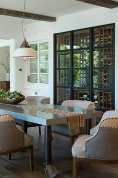 Steel Doors Wine room. Modern wine room with steel doors in dining room…