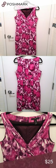 H&M - Floral Dress - Size 12 Worn and washed a few times - in perfect condition. This H&M floral dress in size 12 is fully lined and is perfect for Spring and Summer! The abstract floral print provides a welcome and celebratory pop of color to any event. Falls just below the knee and has a zipper back. Made of cotton and polyester. H&M Dresses