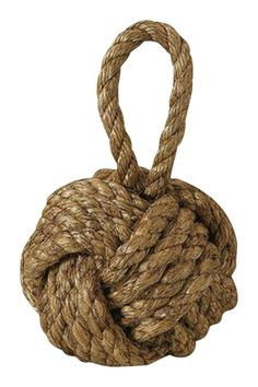"Specially crafted with Jute and is very versatile. The door stopper adds a boat feel in a decorative way. Hang it or place it on the ground shelves or anywhere else in your beach home.  Measures:10""H x 6Dia  Rope Door Stopper by Two's Company. Home & Gifts - Gifts Rhode Island"
