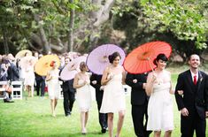 Have your bridesmaids hold parasols instead of flowers