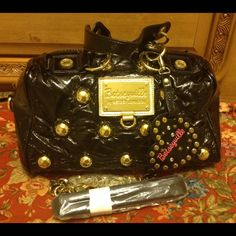 BETSEY JOHNSON STUDDED BAG NWT BLACK Betseyville bag by betsey Johnson. New with tag inside the bag. Black with gold studded accent. Comes with shoulder bag. Sold out in stores. WOW FACTOR BAG RARE!!! Betsey Johnson Bags