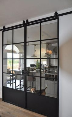 A classic industrial design door on rollers than can keep a small space open due to the thin pane braces yet allow the room to be sectioned off at the same time. [Study Conversion Ideas for An Intelligent Home] #industrialkitchen