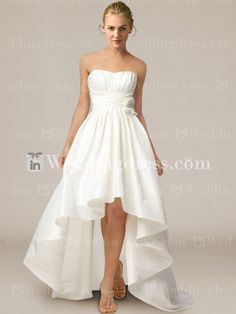 Strapless high low mini ball gown with draped bodice. Sweep train.