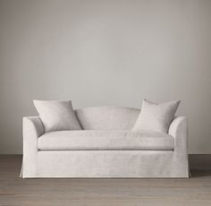 5' Belgian Camelback Slipcovered Sofa | Sofas | Restoration Hardware in Perennials Classic Linen in Natural (stain-resistant indoor/outdoor fabric). Twin loveseats in living room opposite each other.