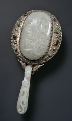 Ming dynasty jade mounted in silver hand mirror. #AsianAntiques #AntiqueSilver
