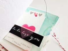 Watercolor pages in a mini album.