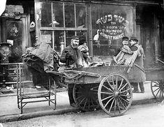 NYC men peddling their goods at Essex Street Market.