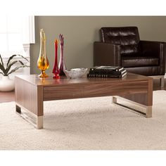 @Overstock.com - Upton Home Agusta Cocktail/ Coffee Table - Providing both storage and display space, the Upton Home Agusta cocktail/coffee table makes a great addition to your family or living room. This table?s convenient drawer, compact feel, and unique design works well with transitional or modern d�cor.  http://www.overstock.com/Home-Garden/Upton-Home-Agusta-Cocktail-Coffee-Table/8379034/product.html?CID=214117 $242.99