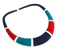 This Navy Red and Teal Multicolor Textile Tribal Bib Statement Necklace makes a unique Gift for Architect and Statement Jewelry! A Fiber necklace or Textile Jewelry is a great choice against metal allergies. Also, this Contemporary Fiber Necklace is Perfect to wear with basic the pieces in your wardrobe, like a plain dress or shirt with jeans, youll have a conversation-starter piece.  --  DETAILS!  - All of my Statement Necklaces are made to order and hand wrapped cotton and acrylic threads…