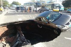 01/15/2015 - In pictures: Huge sinkhole swallows car just moments after driver makes dramatic last-gasp exit - Guangzhou, China