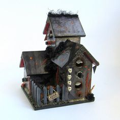 This richly embellished and decoupaged haunted birdhouse captures the real Halloween spirit!  Measures 6 x 6 inches and 8 inches tall.  The fine