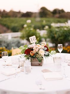 Rustic table decor: http://www.stylemepretty.com/california-weddings/solvang/2015/05/16/lovely-santa-ynez-wedding-at-lincourt-vineyards/ | Photography: Michelle Warren - http://www.mwfoto.com/