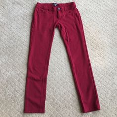 Pretty Red Pants These beautiful red pants are in great condition. I would love to keep them but they don't fit me anymore. The pockets in the front are sewn on and just for looks. They are size large but fit more like a medium! Pants Skinny
