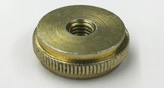 Screw machined products, precision turned parts portfolio - yellow zinc shaft collar. The steel collar is turned, knurled and threaded.