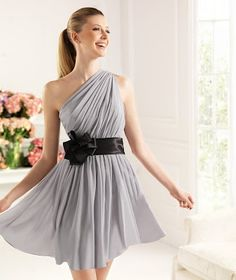 this short dress is gray you can use an ony accacion and its cost is two hundred thirty-five you can use it wwith a shoe heel