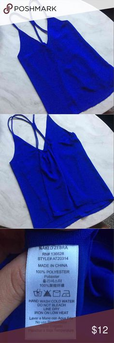 Naked Zebra Dressy V-Neck Tank Purchased from Apricot Lane Boutique in Illinois. Beautiful royal blue, V-neck Halter style tank. Criss cross back detailing. Double layered, light and flowy. Perfect condition only worn twice for a few hours. Can be worn casually or dressed up. Looks great paired with skinny jeans or a leather jacket! Naked Zebra Tops Blouses