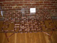 Hilbert Curve fractal coffee table made of copper pipes and glass. I love the geometric twists and turns. #table #furniture #weird #copper #decor