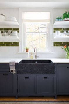 While white kitchen cabinets are classic & colorful kitchen cabinets are, we're ready for something a little moodier: black kitchen cabinets. Paired with bright metals & pops of color, the darkest color on the spectrum can truly shine. Keep reading to see how you can get in on this dark design trend.     #blackcabinets #kitchenideas #kitchendecor #kitchens #interiors #black #metals #green