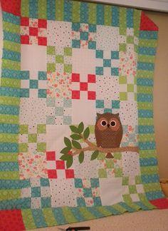 patchwork quilt with applique owl