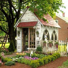 ABSOLUTELY LOVE the church windows in this shed...or a playhouse!!