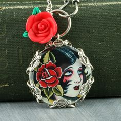Pinup Girl Necklace Tattoo Necklace Gothic Necklace Red Rose Sterling Silver Filigree Old School Tattoo Flash. $43.00, via Etsy.
