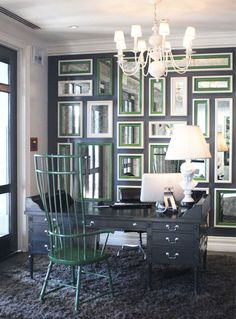 concierge desk, green chair, wall of mirrors