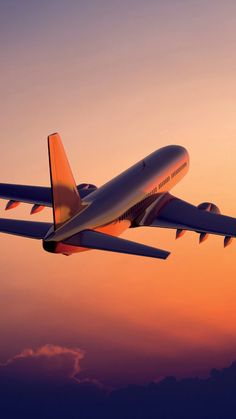 My current background picture I love the airplane flying into the sunset