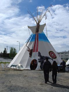 """PSAC's foot"""" tipi at the Assembly of First Nations AGM and Trade Show in Yellowknife, Northwest Territories from July The tipi was touted as the largest ever erected in the North. The painting on the canvas was by Dene artist Archie Beaulieu. Indian Teepee, Native American Teepee, Northwest Territories, Teepees, Event Ideas, First Nations, Corporate Events, Nativity, Survival"""
